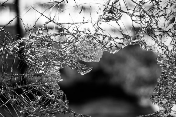 macrophotography of cracked glass screen, by Jilbert Ebrahimi